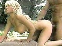 Blonde Asian fucked from behind in park