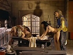 Two alluring bitches perform 69 on table