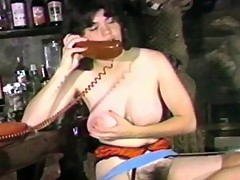 Horny brunette babe masturbates in the bar