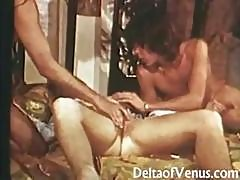 Even Two Cocks Are Not Enough For This Young Hoochie From A Retro Porn Video