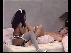 Tom Byron fucking a black chick in porn scene